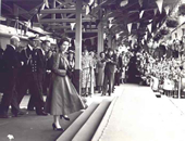 Queen Elizabeth II and the Duke of Edinburgh step off the train at Ballymoney Station